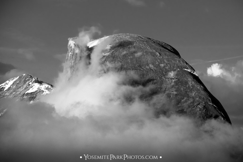 Low clouds swallowing Half Dome - black and white closeup