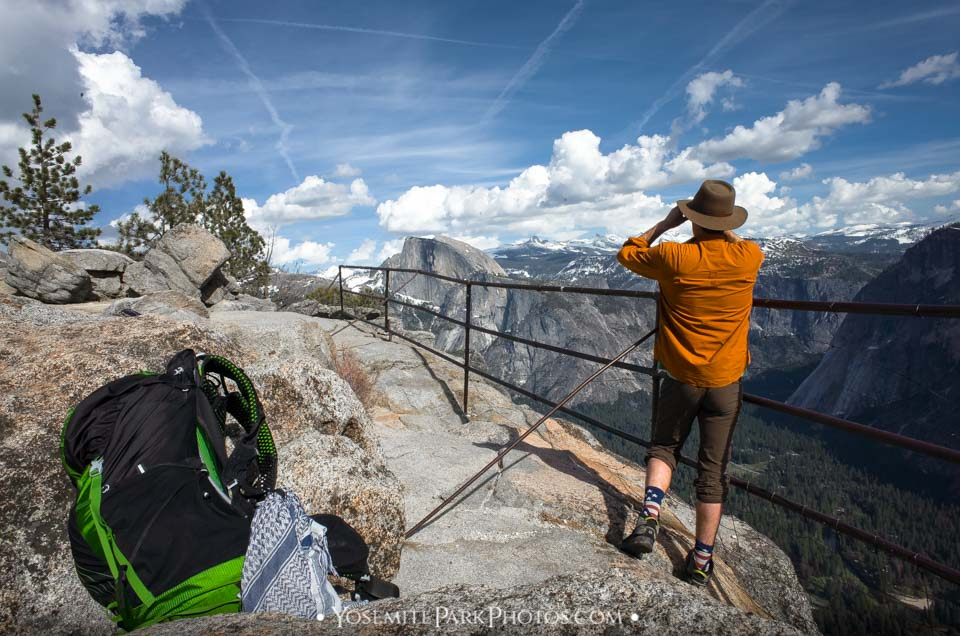 Backpacker observing Half Dome with Binoculars, from Yosemite Point