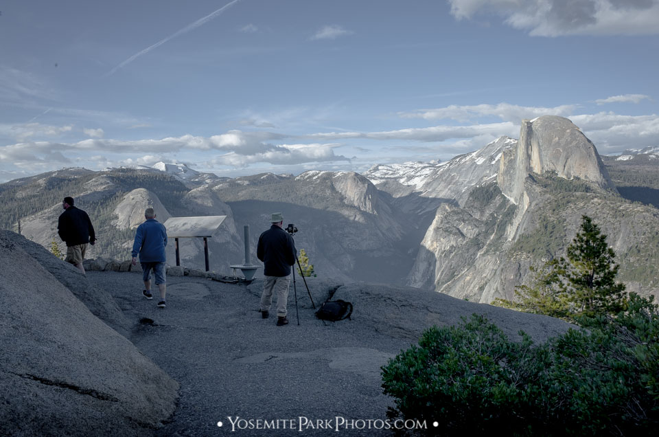 Glacier Point Photographer with tripod waiting for best light on Half Dome