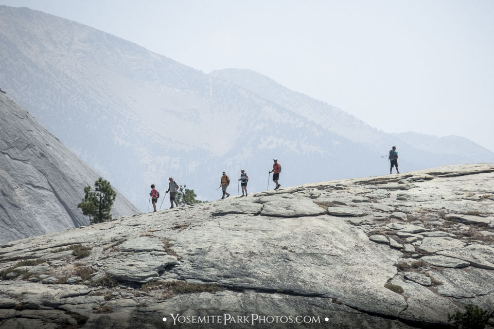 Backcountry hikers on the granite rock, on their way to Half Dome