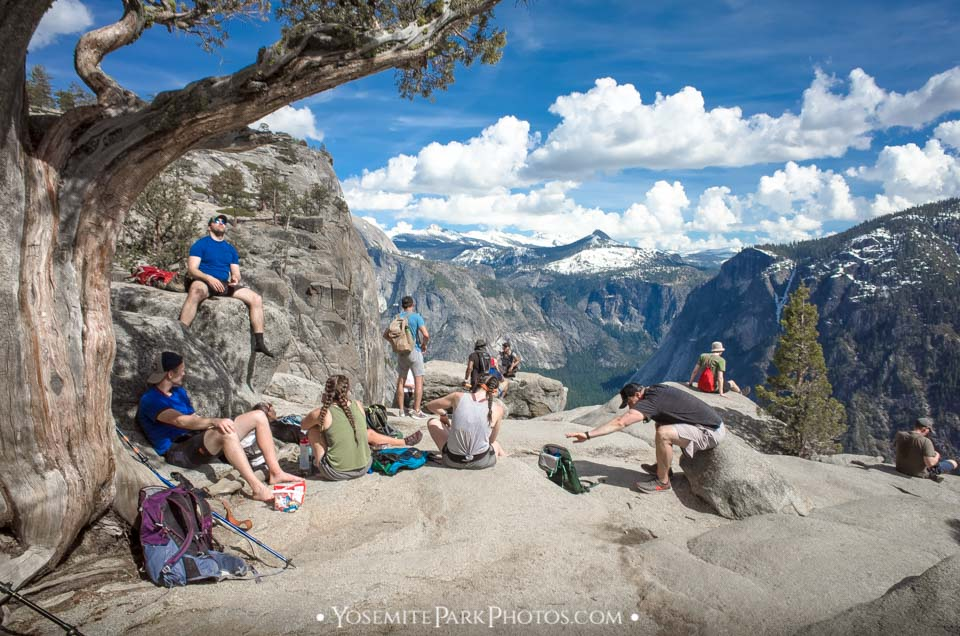 Hikers enjoying the view at the top of Upper Yosemite Falls Trail - Editorial Photo
