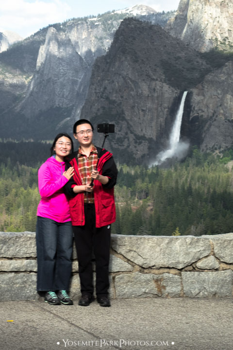 """Chinese tourists taking a """"selfie"""" in front of Bridalveil Fall - Yosemite Editorial"""