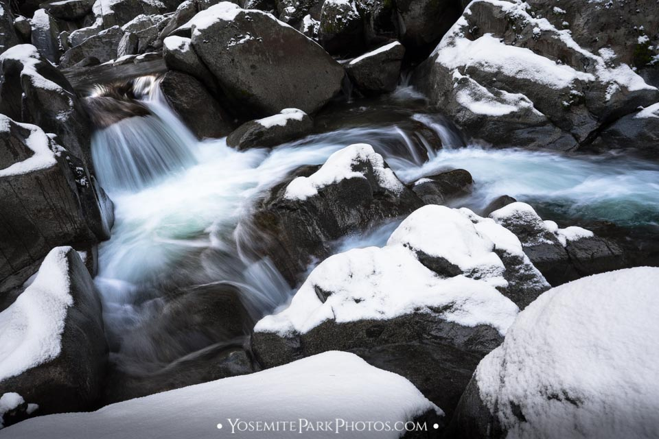 Long exposure waterfalls Along Snow Covered Tuolumne River