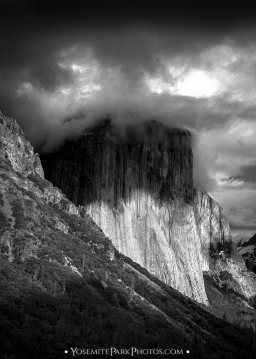 Dark storm cloud contrasting El Capitan - portrait, black and white