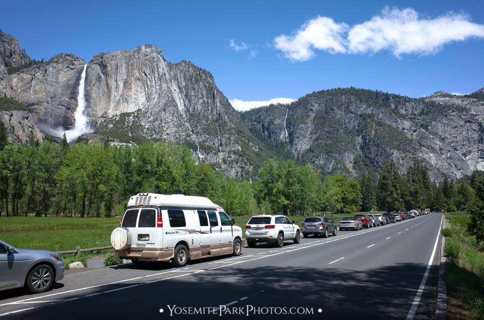 Line of tourist cars parked along Sentinel Meadow, with Yosemite Falls View - springtime