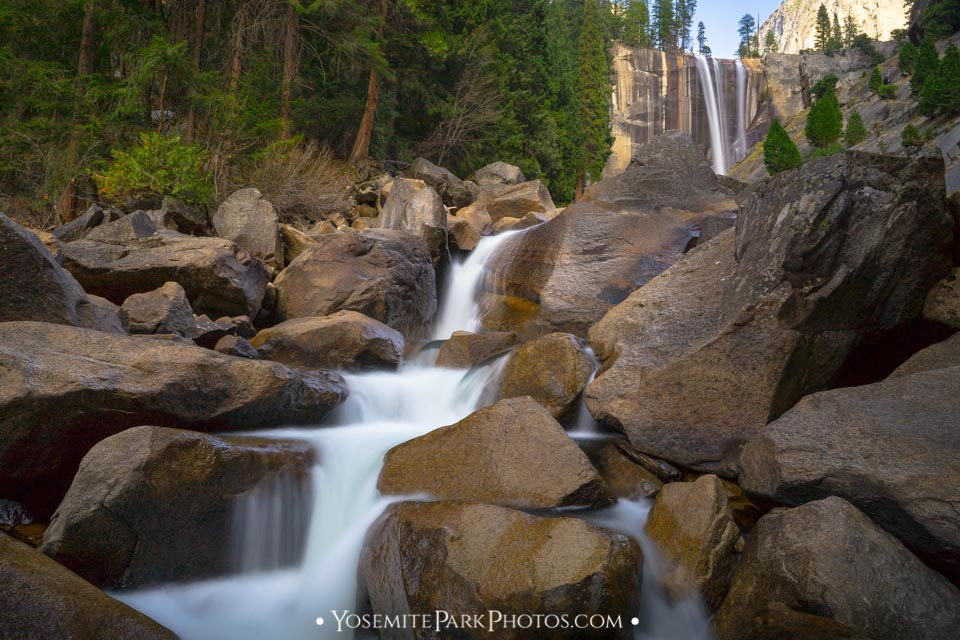 View of Vernal Falls from boulders and smaller waterfalls at the base, late summer