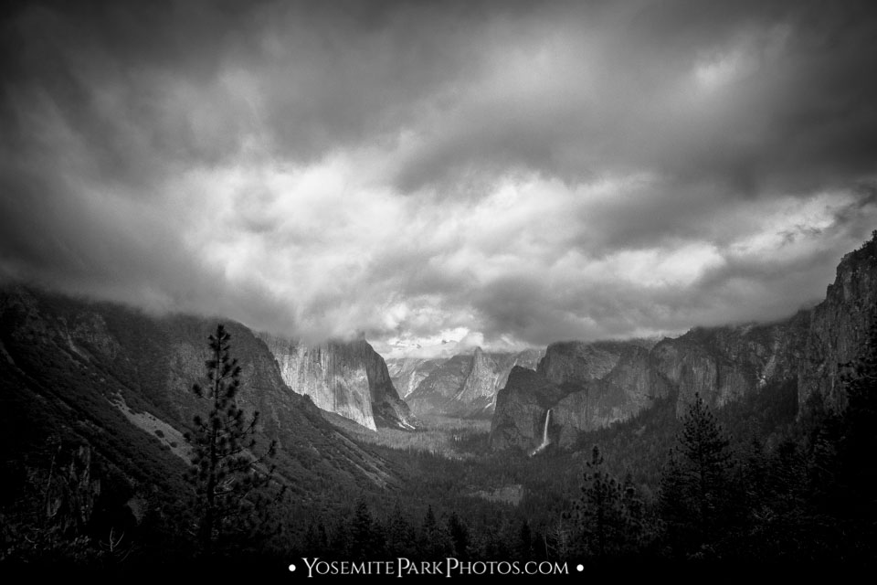 Dark storm clouds rolling in over Yosemite Valley, b&w